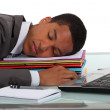 Stock Photo: Businessman asleep on pile of folders
