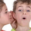 Little girl telling his brother a secret — Stock Photo