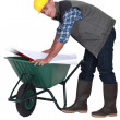 Stock Photo: Bricklayer on trolley