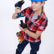 Craftswoman putting a charger in a drill — Stock Photo #11849050