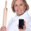 A baker holding a mobile phone — Stock Photo #11849227
