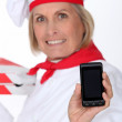 Cook showing phone — Stock Photo