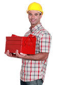 Workman carrying toolbox — Stock Photo