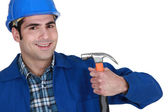 Not sure it's the right way to hold a hammer — Stock Photo