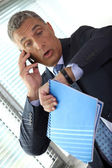 Shocked businessman realizing he is late — Stock Photo