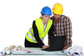 Architect and builder discussing a project — Stock Photo