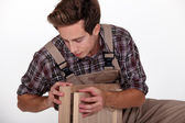 Craftsman assembling wooden pieces — Stock Photo