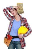 Tired female builder — Stock Photo