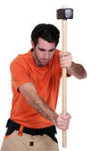 A ma with a sledgehammer. — Stock Photo