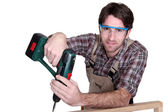 Craftsman holding a drill — Stock Photo