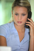 Blond receptionist taking a call — Stock Photo