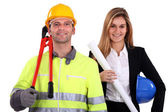 Portrait of fine-looking female architect and workman — Stock Photo