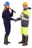 Tradespeople shaking hands — Stock Photo