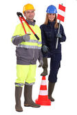 Manual workers stood with traffic cones — Stock Photo