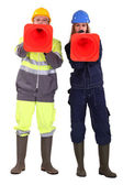 Two traffic workers shouting through cones — Stock Photo