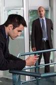 Man making a personal call at work — Stock Photo