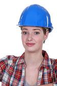 A nervous-looking tradeswoman — Stock Photo