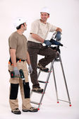 Two handymen at work. — Foto de Stock