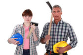 Craftsman and craftswoman posing together — Stock Photo