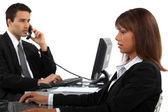 Two businesspeople hard at work — Stock Photo