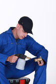 Plumber using blow torch on brass pipe — Stock Photo