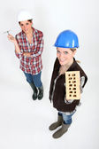 Women with trowel and brick — Stock Photo