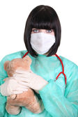 Nurse wearing surgical mask in paediatric unit — Stock Photo