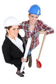 Blue collar worker standing next to an engineer — Stock Photo