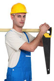 A carpenter with a handsaw. — Stock Photo