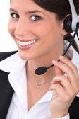 Brunette receptionist wearing head-set — Stock Photo