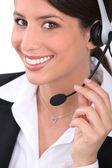 Brunette receptionist wearing head-set — Stock Photo