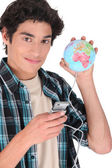 Teenager connecting all over the world — Stock Photo