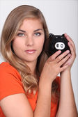 Woman with a piggy bank — Stock Photo