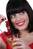 Woman eating fruit salad — Stok fotoğraf