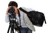 Liten pojke klädd som kameraman — Stockfoto