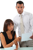 Business couple going over paperwork — Stockfoto
