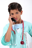 Boy dressed as a nurse — Stock Photo