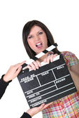 A woman having a hand caught in a movie clap — Stock Photo