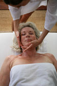 Woman receiving a massage at the spa — Stock Photo