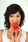 Young woman with red heart in hand — Stock Photo