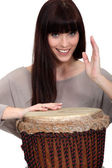 Woman playing percussion. — Stock Photo