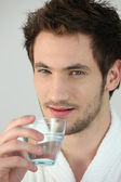 Young man with glass of water — Stock Photo