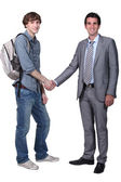 Student shaking teacher's hand — Stock Photo