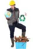 Tradesman campaigning to have more recycling facilities available worldwide — Stock Photo