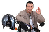 Man on his motorbike making an okay sign — Stock Photo
