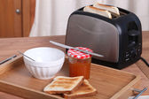Toaster alongside toast and marmalade — Stock Photo