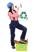 Eco-friendly tradeswoman yelling into a megaphone — Stock Photo