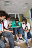 Teenagers sat on school steps — Stock Photo