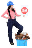 Woman with box of debris and stop sign — Stock Photo