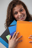 Administrative worker holding lots of folders — Zdjęcie stockowe